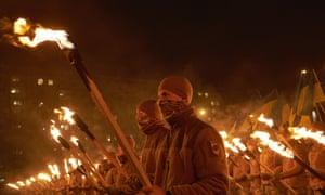 Members of ultra-nationalist paramilitary Ukrainian group Azov march in Lenin Square last December in Mariupol, Ukraine.
