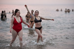 Students take part in the traditional May Day dip at East Sands beach in Fife