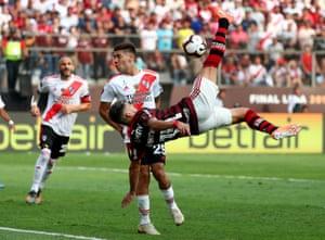 Flamengo's Giorgian de Arrascaeta shoots at goal with an overhead kick.