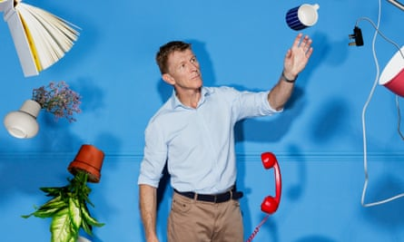 Tim Peake with household objects that look like they are floating