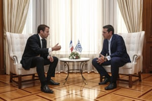 Greek Prime Minister Alexis Tsipras, right, and French President Emmanuel Macron speaking today.