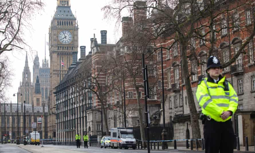 Police officers stand guard on Victoria Embankment  in London