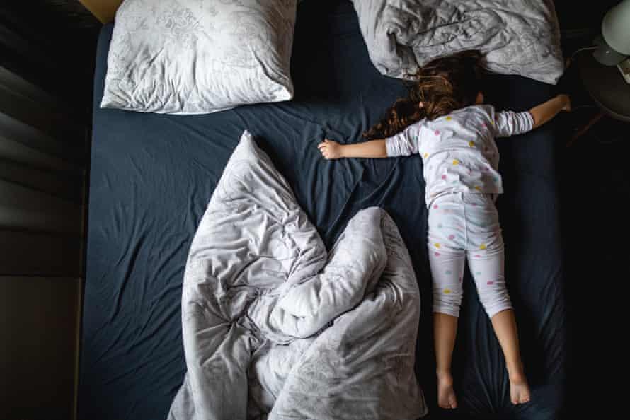 A girl asleep on a mattress