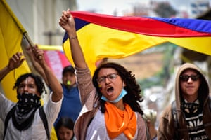Protesters fly the flag in Pasto on the eighth day of a national strike