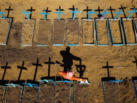 A gravedigger stands at the Nossa Senhora Aparecida cemetery in Taruma, Manaus, where Covid-19 victims are buried daily, on 2 June.