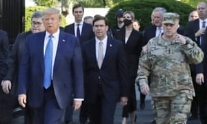 Donald Trump departs the White House on 1 June, with Mark Esper and Gen Mark Milley to his left.