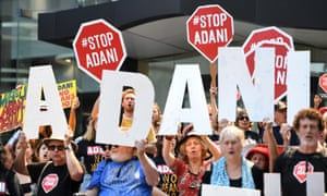 The Queensland government has approved Adani's groundwater plans, meaning the Carmichael coal mine is cleared to go ahead. Pictured: Anti-Adani protesters