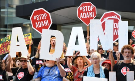 Aurizon is in talks with Adani about upgrading the rail network. Anti-Adani protesters outside the company's Brisbane offices in September.