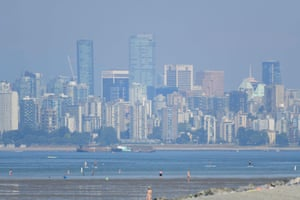 A heat haze blankets Vancouver. The police department said it had redeployed dozens of officers and asked the public to call 911 only for emergencies because heat-related deaths had depleted frontline resources and delayed response times