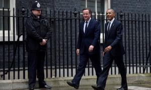 Barack Obama and David Cameron walk along Downing Street