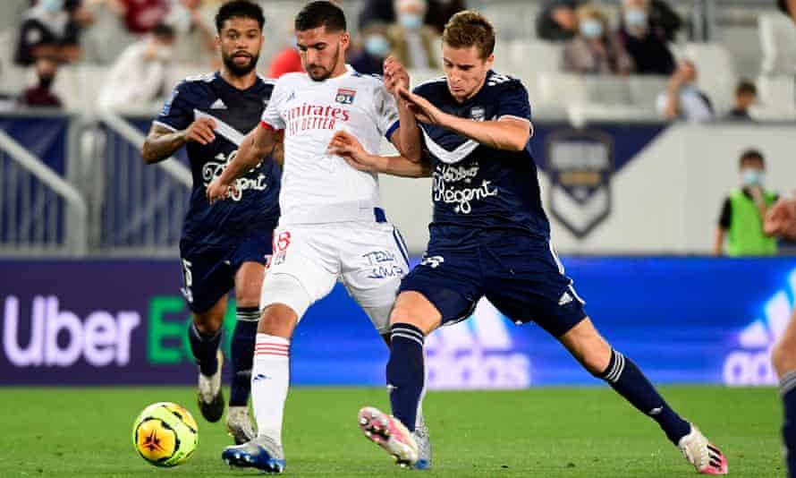 Houssem Aouar, centre, in action for Lyon against Bordeaux on 11 September.