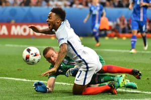 Raheem Sterling goes down under the challenge of Iceland's goalkeeper Hannes Thor Halldorsson.