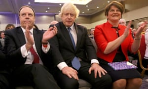 Nigel Dodds, Boris Johnson and Arlene Foster at the DUP's annual conference in Belfast last November.
