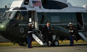 Trump steps off Marine One on his way to board Air Force One at Andrews Air Force base on Thursday
