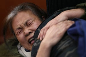 A woman whose daughter was on board MH370 cries before a meeting with Malaysian Airlines officials in Beijing