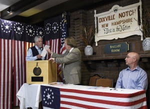 Selectman Les Otten casts the first ballot of the New Hampshire primary in Dixville Notch, N.H.