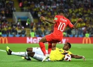 England make a lively start. Here, Yerry Mina tackles Raheem Sterling but ends up conceding a free-kick as he drags the ball away with his trailing away.