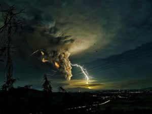 Lightning strikes in the dust cloud over Batangas as Taal Volcano continues its eruption on Sunday evening.