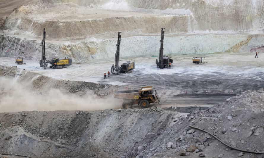 A truck arrives to ferry excavated gold, copper and zinc ore from the main mining pit at the Bisha Mining Share Company in Eritrea
