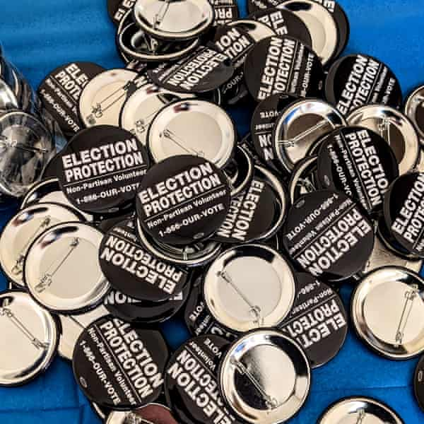 """Buttons say """"election protection"""""""