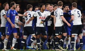 Mark Clattenburg, fifth from right, tries to keep the Tottenham and Chelsea players apart during a tempestuous game.
