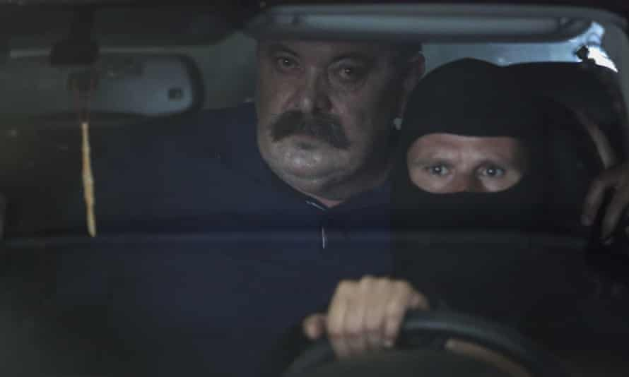 Christos Pappas leaves court in Athens in a police anti-terrorism vehicle