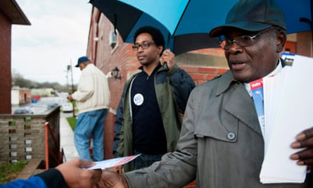 Wesley Bell, left, handing out election information with Lee Smith, right, gained national attention when he won a seat on Ferguson city council in 2015.