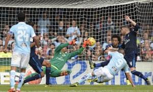 Keylor Navas saves a shot by Celta Vigo's Iago Aspas, second right, during Real Madrid's 3-1 win at the weekend.