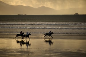 Runners and riders participate in the Christmas Ballyheigue beach horse races in County Kerry