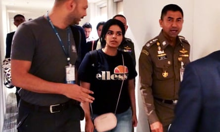 Rahaf Mohammed al-Qunun is escorted by Thai and UNHCR officials at the Suvarnabhumi international airport in Bangkok on Monday.