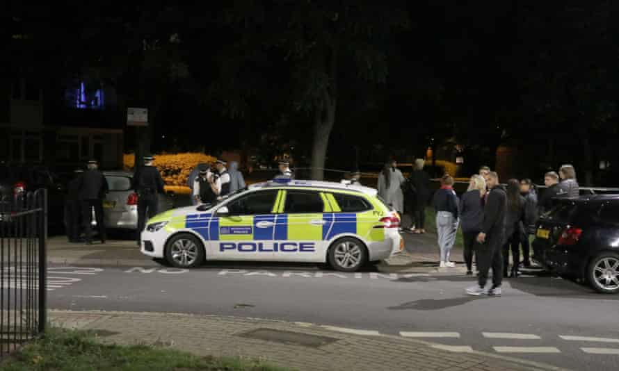 Police officers at the scene of the man's death in Wandsworth, south-west London.