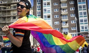 A man with a rainbow flag at last year's Brighton and Hove Pride