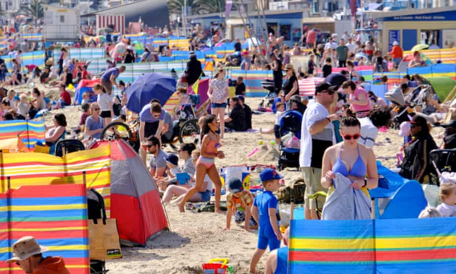 Visitors to Weymouth pack out the beach in the sunshine.
