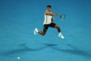 Michael Mmoh flings a forehand to Rafael Nadal.