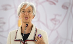 International Monetary Fund (IMF) Managing Director Christine Lagarde wearing a badge showing solidarity with a Swiss nation-wide women's strike for wage parity during her speech at the ILO International Labour Conference in June
