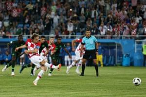 Luka Modric slots home.