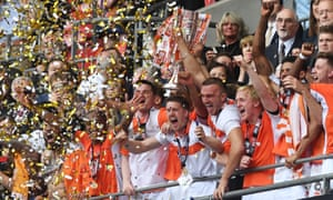 The jubilant Blackpool players celebrate their promotion to League One.