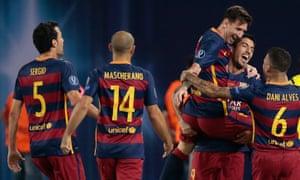 Messi celebrates with Luis Suarez.