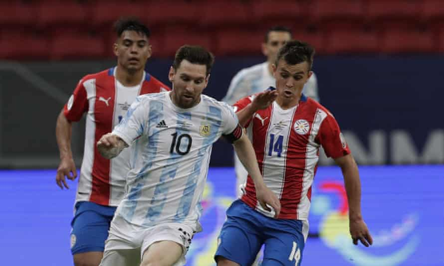 Lionel Messi, still seeking his first major title with Argentina, on the run from Paraguay's Andrés Cubas.