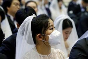 A bride wears a mask