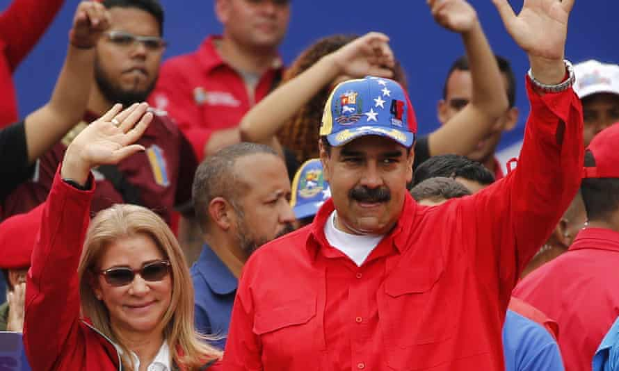 Nicolás Maduro and the first lady, Cilia Flores, acknowledge supporters at the end of a rally in Caracas on Saturday.