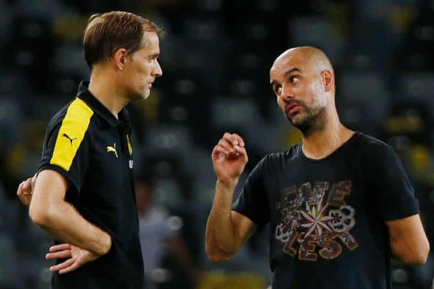 Thomas Tuchel and Pep Guardiola deep in conversation when Borussia Dortmund faced Manchester City at the International Champions Cup in China in July 2016.