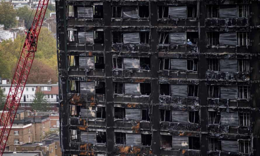Police investigators at Grenfell Tower in London