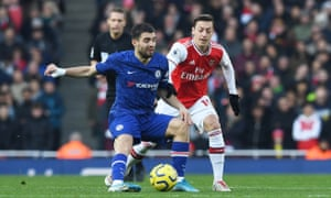 The back-in-favour Mesut Özil  challenges Mateo Kovacic
