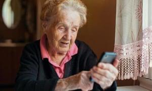 A woman uses a smartphone
