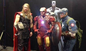 Avengers cosplayers dressed as Thor, Iron Man and Captain America.