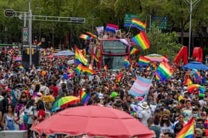 Mexico City, Mexico. Attendees waving rainbow flags during the 43rd annual Pride march on the main avenue