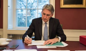 Philip Hammond puts the finishing touches on his autumn statement at No 11 Downing Street.
