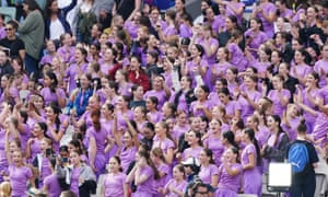 Australia supporters wear purple to mark International Women's Day during the Women's T20 World Cup final match between Australia and India at the MCG in Melbourne, Australia, 08 March 2020.
