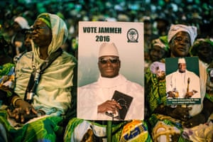 Supporters of the Gambian president hold a placard reading 'Vote Jammeh' during the closing rally of the electoral campaign in Banjul.